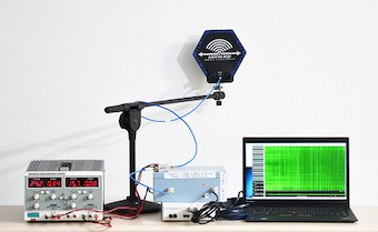 Attacker's setup for capturing EM emanations. Left to right: power supply, antenna on a stand, amplifiers, software defined radio (white box), analysis computer (pic courtesy researchers)